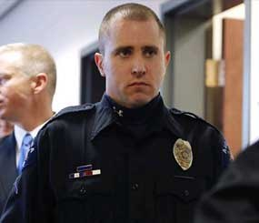 Aurora Police Officer Justin Grizzel leaves court after testifying at a preliminary hearing for James Holmes at the courthouse in Centennial, Colo., on Monday, Jan. 7.
