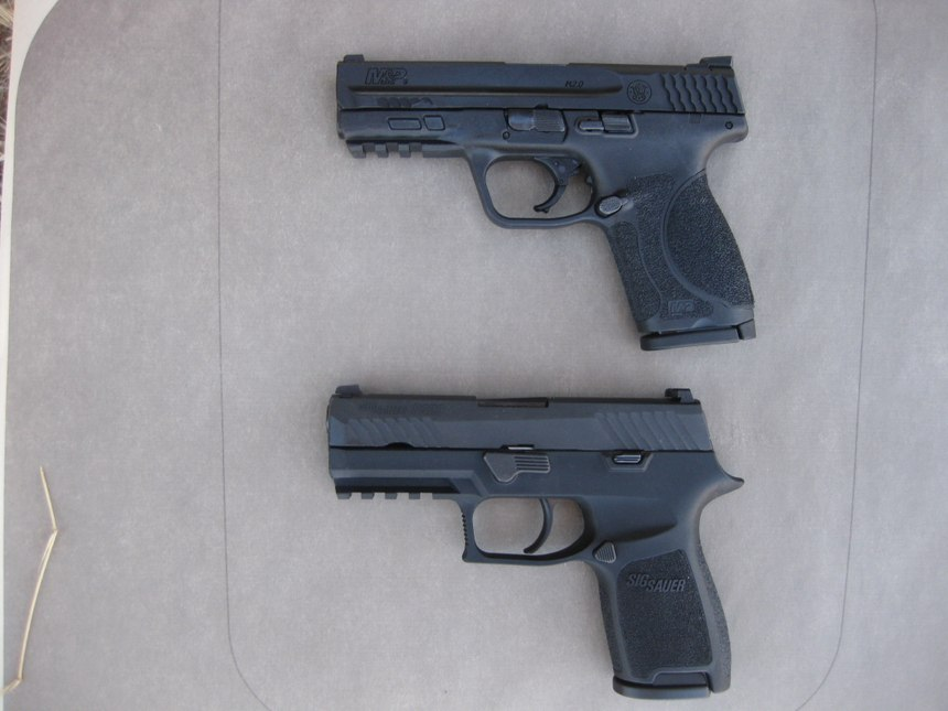 The 9mm Smith and Wesson M&P 2.0 Compact (top) and the 9mm SIG P320 Compact (bottom). (Photo/Nick Jacobellis)