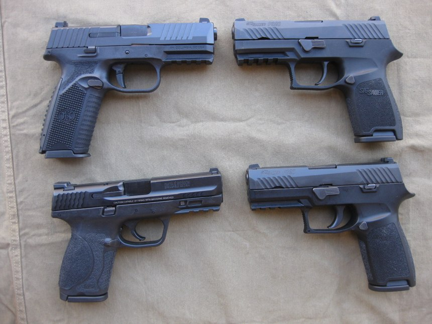 The FN 509 (top left), the SIG P320 Compact (top right), the Smith and Wesson M&P 2.0 Compact (bottom left) and the SIG P320 Carry (bottom right). (Photo/Nick Jacobellis)