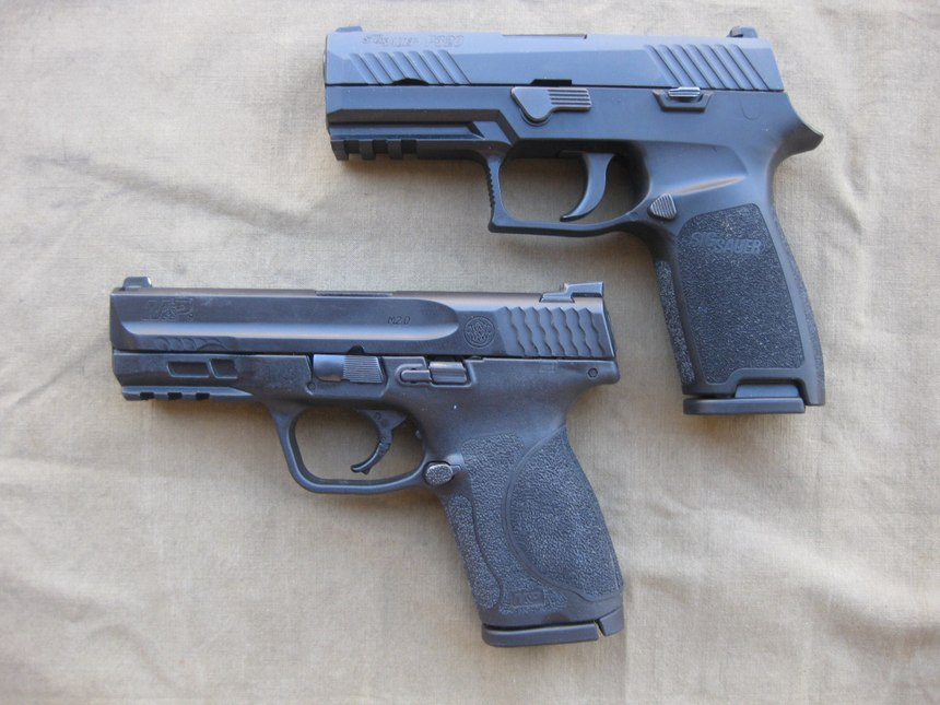 The SIG P320 Compact (top) and the Smith and Wesson M&P 2.0 (bottom) are top guns for concealed carry. (Photo/Nick Jacobellis)