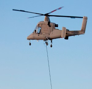 The Unmanned K-MAX multi-mission helicopter is an Unmanned Aerial Truck (UAT) based on the K-MAX heavy-lift aerial truck helicopter. (Image Kaman)