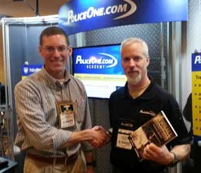 Mike Wood (left) pictured with Doug Wyllie at the PoliceOne booth at SHOT Show 2014.