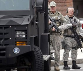 """Armored vehicles and other so-called """"militarized"""" looking equipment is essential to missions such as responding to violent crimes in progress like armed robberies and active-shooter incidents, barricaded subjects, hostage situations, as well as for searching for suspects like Dzhokhar and Tamerlan Tsarnaev, which is exactly what the officers pictured above were doing when this image was taken."""