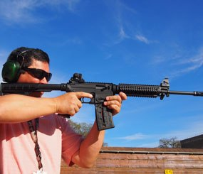 The  Mossberg International 715T is essentially a Mossberg 702 Plinkster in a molded AR-15 (A2 style) shell.