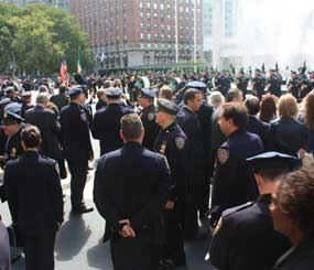 The pipes and drums of the NYPD Emerald Society perform after the ceremony held Thursday, September 8, 2011 at the palatial Avery Fisher Hall of the world-famous Lincoln Center.