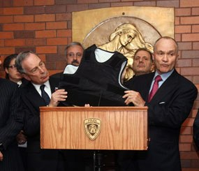 New York Mayor Michael Bloomberg and Police Commissioner Raymond Kelly show off the body armor that prevented Officer Robert Salerno from being fatally wounded.
