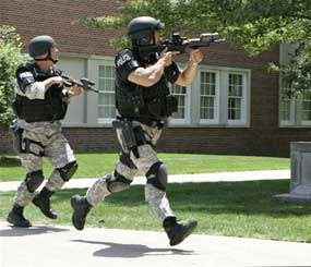 Police officers from the Omaha Emergency Response Unit conduct training for a possible