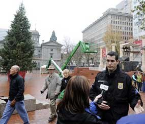 Portland police sergeant Pete Simpson in Pioneer square after a car bomb plot by a Somali-born teenager was foiled during the annual tree lighting ceremony.