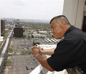 Phoenix police officer David Salgado looks out over the Phoenix skyline Monday, May 17, 2010. Salgado, an opponent of the new immigration law in Arizona, has sued the city of Phoenix and the governor over the measure.