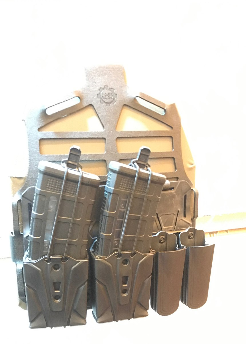 S and S Precision takes a different approach to holster and plate carrier manufacture. The plate carrier starts with a precision-cut web called a PlateFrame that fits around the plate. A cummerbund, shoulder straps and tool-hanging devices are added. The holster mounts and Trifecta Connecta were designed to accommodate a number of different popular holsters, allowing police officers to adjust the height and use the same holster for duty as they would for critical response. (Photo/PoliceOne)