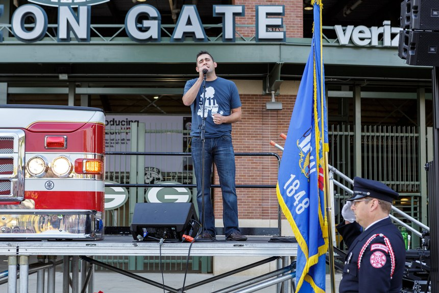 Paul Cummings, a firefighter and singer/songwriter sings the national anthem.