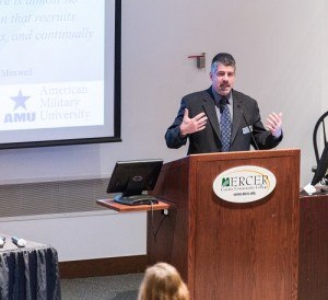 AMU professor Dr. Michael Pittaro discusses the importance of transformational leadership practices during his keynote address at the NJACA conference. (Photo: Mike Hickman Photography)
