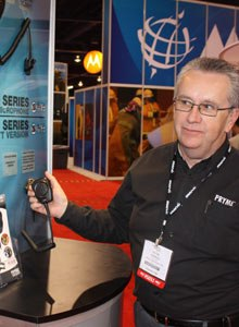 Photo Scott BrunerPryme president David George demonstrates Pryme's new WTX-4100 Tactical Microphone.
