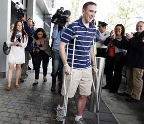 Officer Richard Donohue, who survived a showdown with the Boston Marathon bombing suspects, headed home Friday. (AP Image)