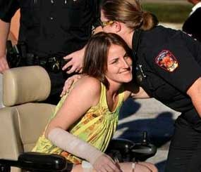 Auburndale Police Officer Stacy Booth used a red electronic wheelchair to get around the parking lot of the McDonald's at 420 Havendale Blvd. as she greeted those who came to support the fundraiser to help pay for her medical expenses. (Photo by The Ledger)