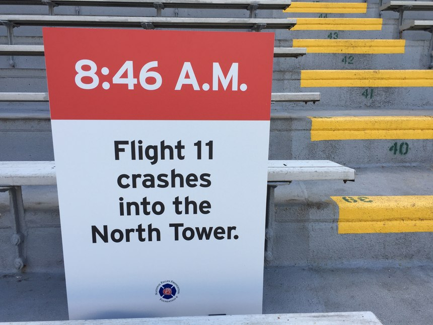 Signs throughout the stadium were a solemn reminder of why we were climbing: to remember.