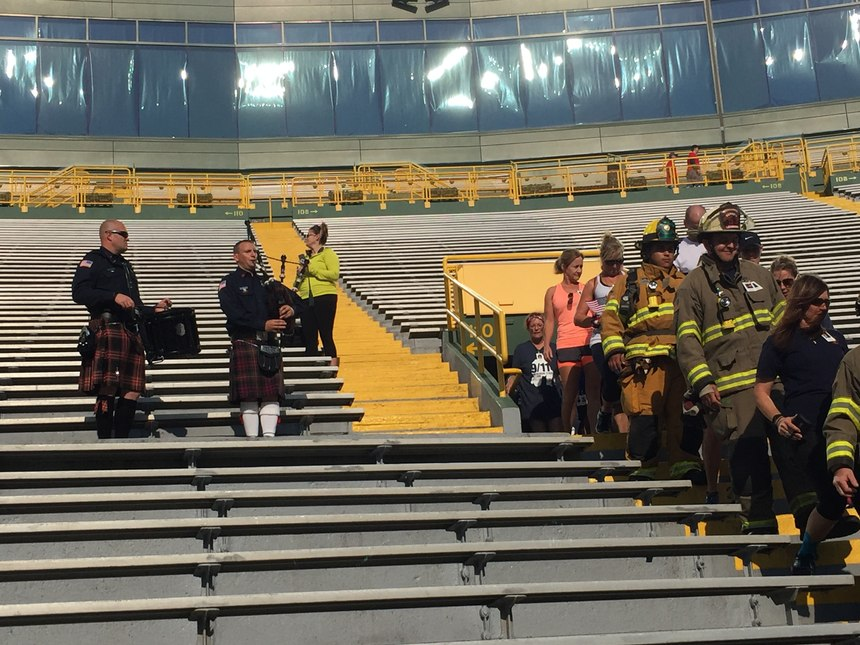 A drummer and bag pipe player led climbers into the stadium.
