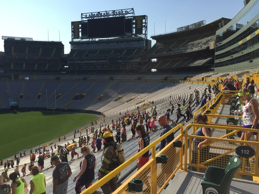 Climbers fan out across the sections on the west side of Lambeau Field.