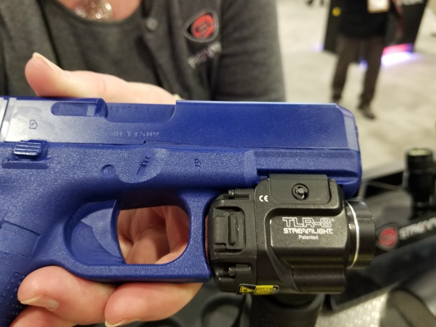 When you need to swap out the single CR123 on the Streamlight TLR-7 and TLR-8, you no longer need to take the light off your weapon. (Photo/PoliceOne)
