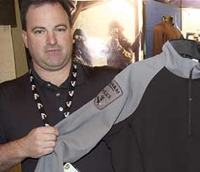 Glen Turpin of Tac Wear is also an officer in Toronto, Canada, and displays a garment that is essentially CoolMax under shirt attached to poly-cotton BDU sleeves, this one with his own actual agency patches on it.