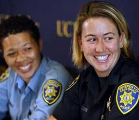Lisa Campbell, manager of the University of California Police Department Special Events, left, and UC Berkeley police officer Ally Jacobs recall their interaction with kidnapping suspect Phillip Craig Garrido at a news conference in Berkeley, Calif., on Friday, Aug. 28, 2009. (AP Photo/San Francisco Chronicle, Paul Chinn)