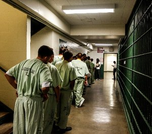 A line at the Men's Central Jail forms as inside the general area where inmates take breaks are waiting to be helped by the ACLU of Southern California, who are registering inmates that are eligible to vote. (Maria Alejandra Cardona\ Los Angeles Times/TNS)