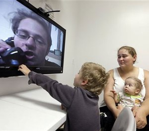 In this photo taken on Tuesday, May 5, 2015, inmate Jesse Cole is shown on a television screen during a video visitation with at the Fort Bend County Jail, in Richmond, Texas. (AP Photo/David J. Phillip)