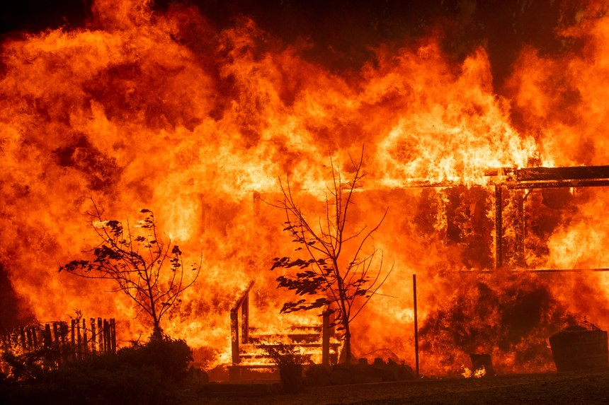 Flames consume a home as the River Fire tears though Lakeport, Calif. (Photo/AP)