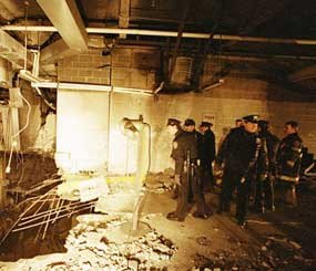 In this file photo of Feb. 27, 1993, police and firefighters inspect the bomb creater inside an underground parking garage of New York's World Trade Center the day after an explosion tore through it. Twenty years ago next week, a group of terrorists blew up explosives under one of the towers, killing six people and ushering in an era of terrorism on American soil.