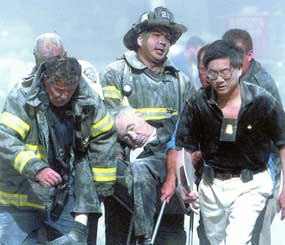 FBI ASAC Wesley Wong (right) and a group of FDNY firefighters found the very first listed victim of 9/11 — Father Mychal Judge, the beloved Chaplain of the FDNY.