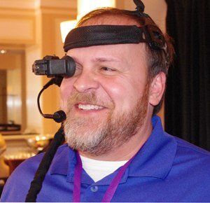 Ken Shrum of Impact Instrumentation demonstrating the E.L.A.D. headset (Image Dan White)