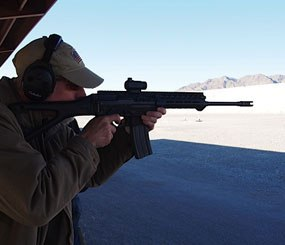 Editor in Chief Doug Wyllie is pictured with the new SIG556xi rifle.