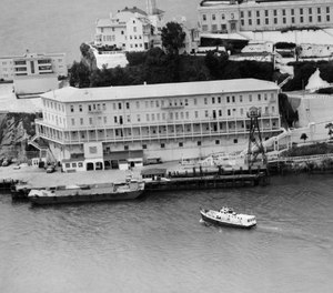 In this June 12, 1962, file photo, Alcatraz Federal Penitentiary in San Francisco Bay is shown the day three prisoners escaped.