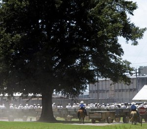 In this Aug. 10, 2009, file photo, prisoners ride wagons from their jobs in agricultural fields surrounding the Cummins and Varner units of the Arkansas Department of Correction complex near Varner, Ark.
