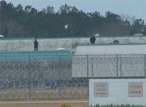 Armed guards stand on the roof of the Lee Correctional Institution near Bishopville, S.C., on Feb. 26, 2015/ (Photo WLTX)