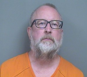 Scott Schlemmer, 60, is accused of assaulting two EMTs and a police officer after allegedly threatening to shoot people at a senior residential facility. (Photo/Mahoning County Sheriff's Office)
