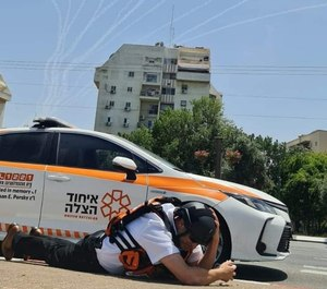 United Hatzalah's Dov Maisel takes cover: Maisel discusses safety and the emotional toll of the recent MCI events in Israel.