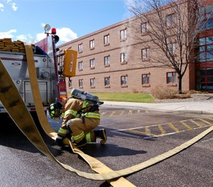 A firefighter disconnects LDH during a training exercise.