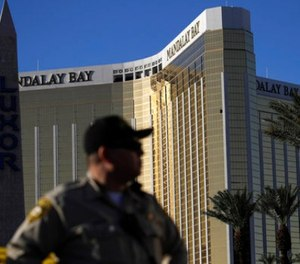 In this Oct. 3, 2017 file photo, a Las Vegas police officer stands by a blocked off area near the Mandalay Bay casino in Las Vegas.