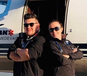 This undated photo shows Respiratory Therapist Roman Valles (left) with one of his colleagues at Peak Medevac. Valles' colleagues helped transport him home to Colorado after he contracted COVID-19 while working on an assignment in Texas. (Photo/Peak Medevac)