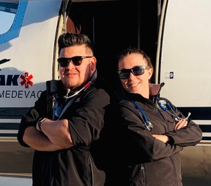 This undated photo shows Respiratory Therapist Roman Valles (left) with one of his colleagues at Peak Medevac. Valles' colleagues helped transport him home to Colorado after he contracted COVID-19 while working on an assignment in Texas.