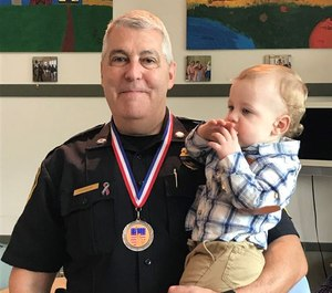 Lt. Alan Lessieurr with his grandson Asher.
