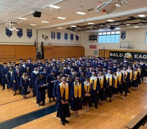 Graduates from the Bald Eagle Area School District wore masks designed and sold by district Athletic Director Doug Dyke to benefit five fire departments and three EMS agencies that serve the district.