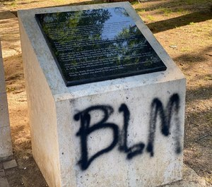 BLM was painted on stone markers and sidewalks at the Peace Officers Memorial.
