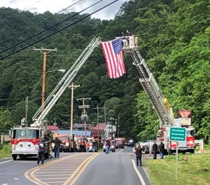 A procession was held on Tuesday to escort Iaeger Volunteer Fire Department Firefighter Russell Roberson home after his line-of-duty death during a house fire. Another Iaeger firefighter, Robert Lee Beckner, has been charged with murder and arson in Roberson's death. (Photo/Iaeger Fire Department Facebook)
