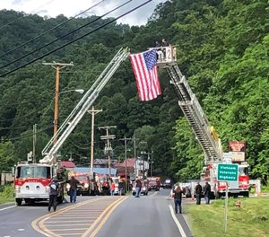 A procession was held on Tuesday to escort Iaeger Volunteer Fire Department Firefighter Russell Roberson home after his line-of-duty death during a house fire. Another Iaeger firefighter, Robert Lee Beckner, has been charged with murder and arson in Roberson's death.
