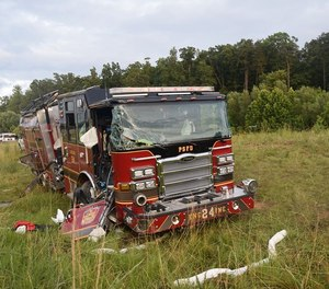 A Pinecroft Sedgefield Fire Department engine rolled over Tuesday night when it swerved to avoid a vehicle that had slowed abruptly in front of it.