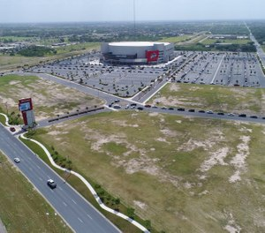 Cars line up for COVID-19 testing at Bert Ogden Arena in Edinburg, Texas on July 8, 2020. Federal, state and local officials in the Rio Grande Valley have established mass testing sites to tackle virus