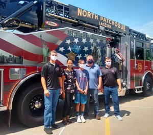 Kyle, 12, and his parents visited North Patchogue Firefighters Steve Welsh (left) and Justin Owen the day after firefighters rescued the boy from a rip current while off duty. (Photo/North Patchogue Fire Department Facebook)