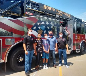 Kyle, 12, and his parents visited North Patchogue Firefighters Steve Welsh (left) and Justin Owen the day after firefighters rescued the boy from a rip current while off duty.